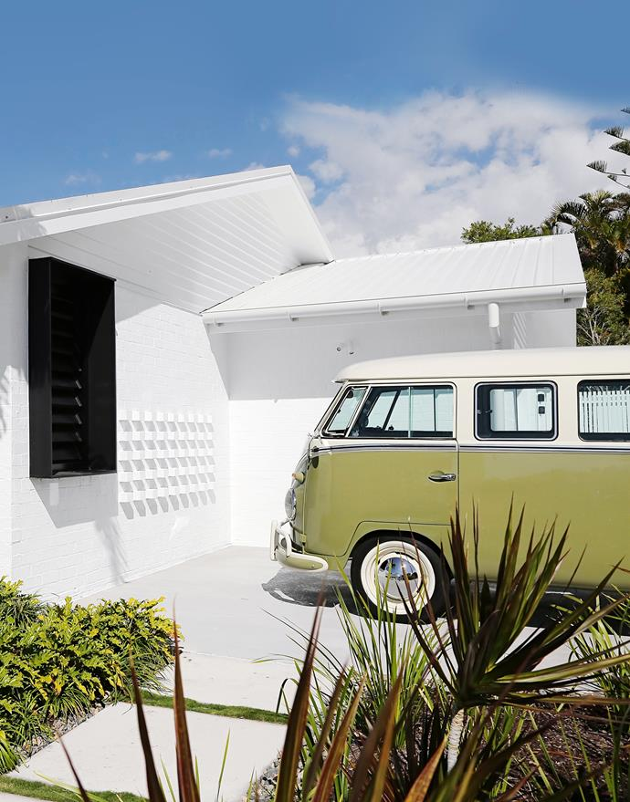 The 1961 Kombi van was imported from Brazil through Chris and Genny's  company, Red Plum Automotive. Schwinn bicycle. Colorbond roofing in Surfmist. Linea cladding, James Hardie. The brickwork utilises bricks recycled from the site. Bricks and cladding painted Dulux White on White.