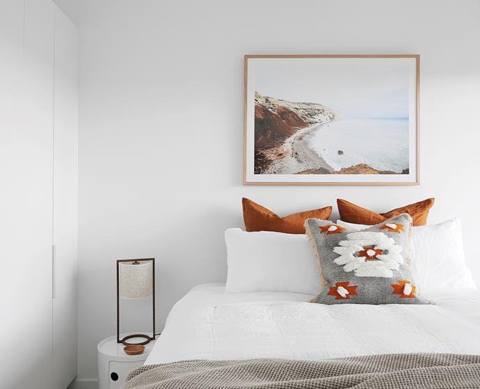 Bedlinen, In Bed. Hepburn throw, L&M Home. Nomad cushion, Fenton & Fenton. Loftus lamp, Temple & Webster. Componobili storage unit, Space. Aphrodite's Cove art print, CLO Studios.
