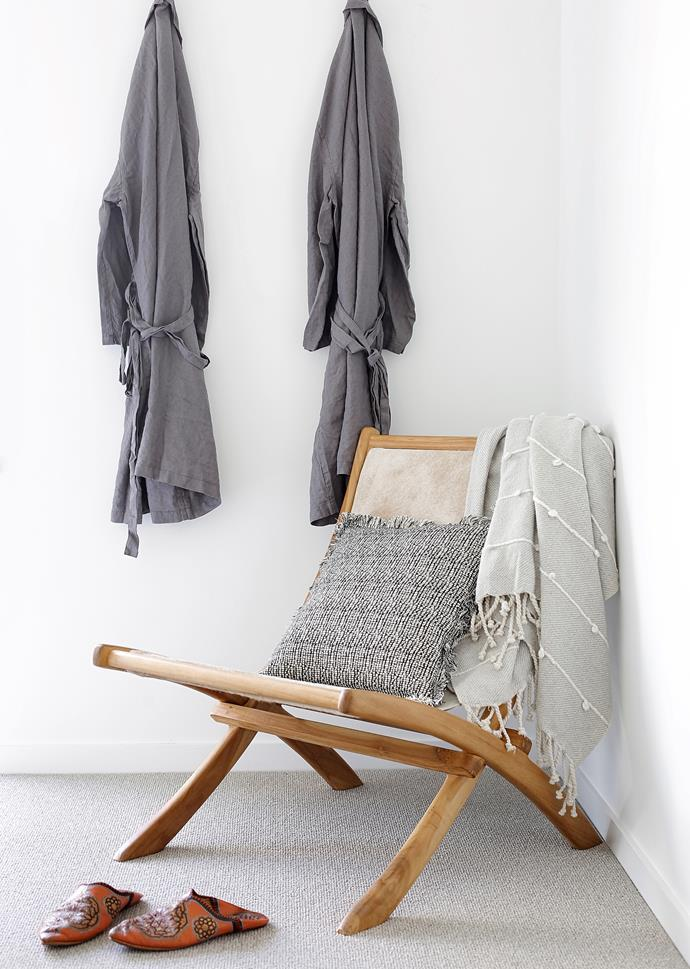 Nook Below Folding chair, CLO Studios. Robes, In Bed. Moroccan slippers.