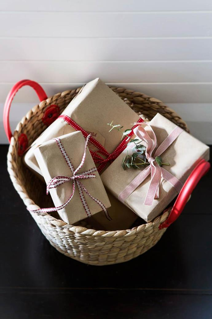 "**Wrap in theme** with some delicate red and white [gift wrapping](https://www.homestolove.com.au/christmas-gift-wrapping-ideas-2017-6028|target=""_blank"") and ribbons. This collection of gifts has paired it with brown wrapping paper to add a laid-back feel. 