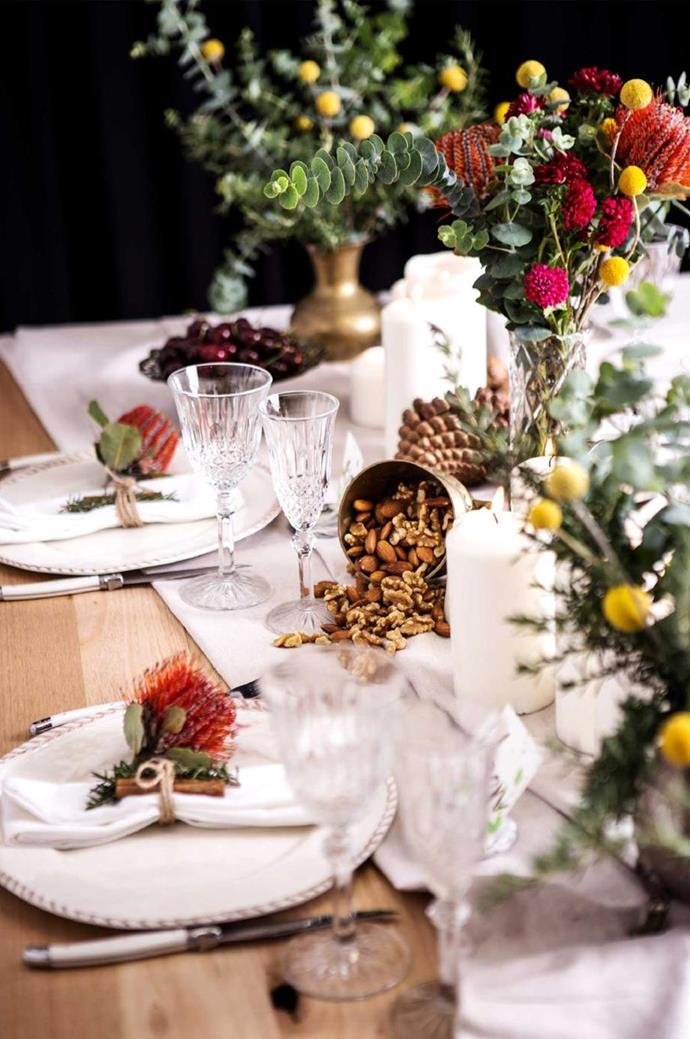 "Native flowers are a beautiful and sustainable way to bring in warm tones to your home. On this table bottle brush is a chic napkin decoration, and paired with native greenery and white linen napery, introduce colour to this stylish [Christmas table setting](https://www.homestolove.com.au/christmas-table-setting-steps-16141|target=""_blank""). Styling: George & Smee 