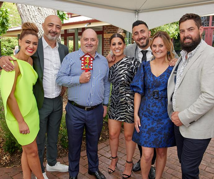 Harry and Tash, Sarah and George, and Daniel and Jade with Danny Wallis, the new owner of their houses.