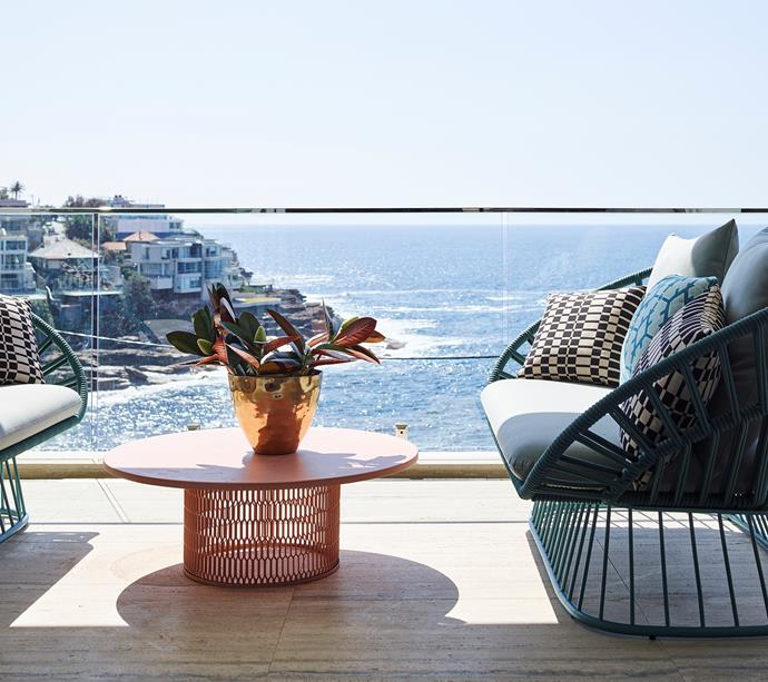 A Kettal 'Mesh' side table and 'Cala' sofas are perched on the balcony overlooking Lurline Bay.