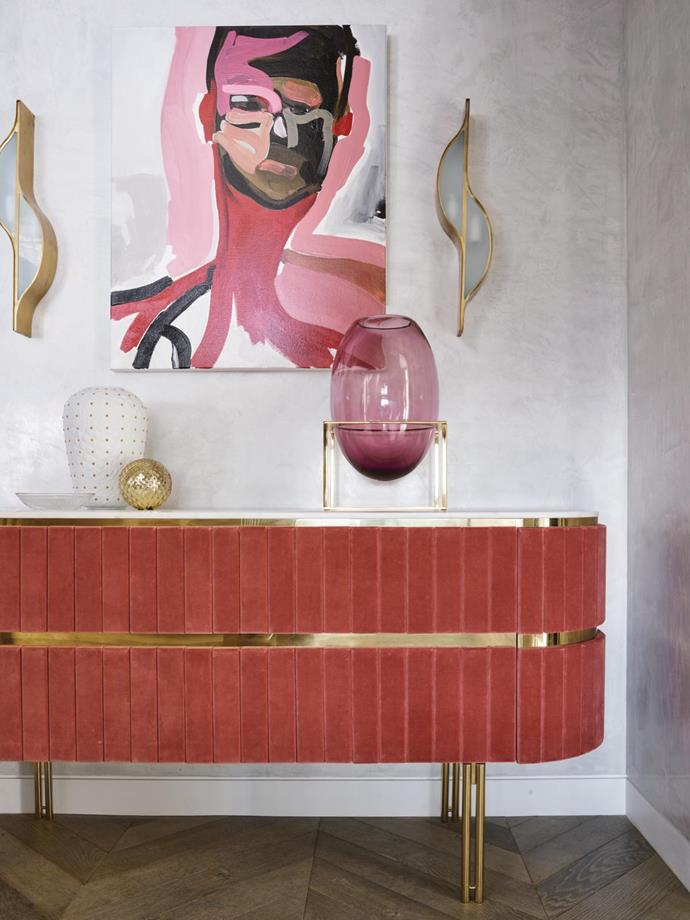 Abandoned by Nunzio Miano is positioned over an 'Edith' sideboard from Essential Home. 'Vanitas' vase from Versace Home, 'Glove' Murano-glass sphere from Robert Cavalli and 'Cube' brass and Murano-glass vase from Fendi Casa.