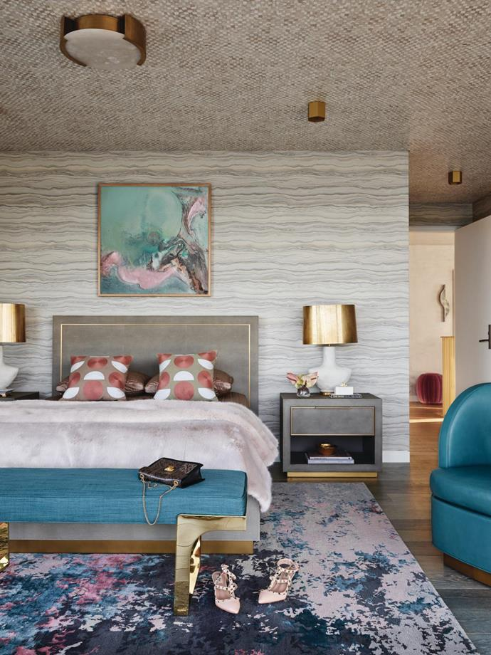 Above the shagreen bed and nightstand from RH, Untitled 11 by Eduardo Santos is exhibited against Thibaut 'Treviso Marble' wallpaper from Boyac. 'Armato' table lamps by Kelly Wearstler.