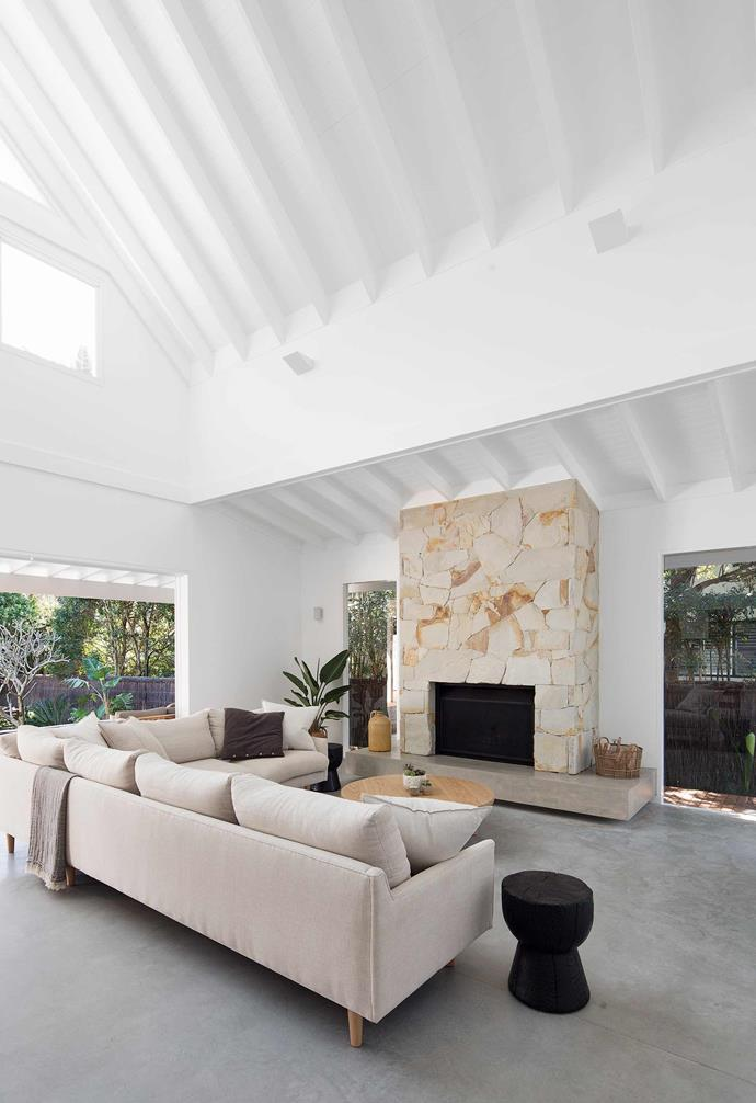 """**Sitting area** The Campanas opted for Mt Angus Sandstone on the fireplace, installed by Stone Hance & Co. Sofa and coffee table, [The Wood Room](https://thewoodroom.com.au/