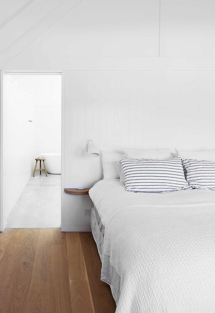 """**Main bedroom** Calm and almost colour-free, this private space features oak on the floor and built-in side table. Caravaggio wall light (custom sprayed in Vivid White by the builder's dad), [Lucretia](https://www.lucretiashop.com.au/