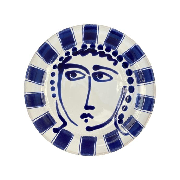 """Ceramic dinner plate with face and striped trim, $120, [Alex Trahanas](https://alexandtrahanas.com/collections/new-arrivals/products/ceramic-main-face-plate-with-stripes-28cm-blue-puglia-italy