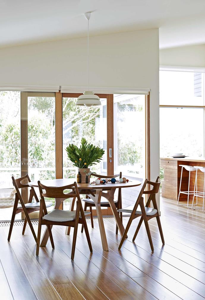 """""""We started a couple of weeks before the building that was originally on the site was demolished,"""" says Mardi. """"It was really nice to see the original house – which inspired the design of the new one – and get a real understanding for the kind of spaces the client desired.""""<br><br>**Dining area** The home boasts a handsome mix of old and new, including vintage chairs from Grandfather's Axe paired with the 'Lyssna' dining table from [Tide Design](https://tidedesign.com.au/