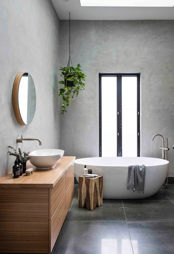 """""""A rustic timber stool by the bath or shower is a great spot for styling a candle, soaps or a small branch of greenery in a vase."""" ~ Fiona Gould, Interior stylist. Photographer: Anna Robinson"""