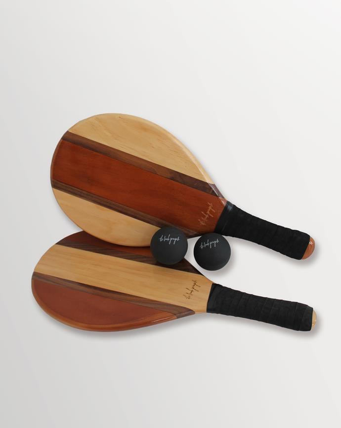 """Paddle & Ball Set, $155, [The Beach People](https://thebeachpeople.com.au/collections/new-arrivals/products/paddle-bat-ball-set