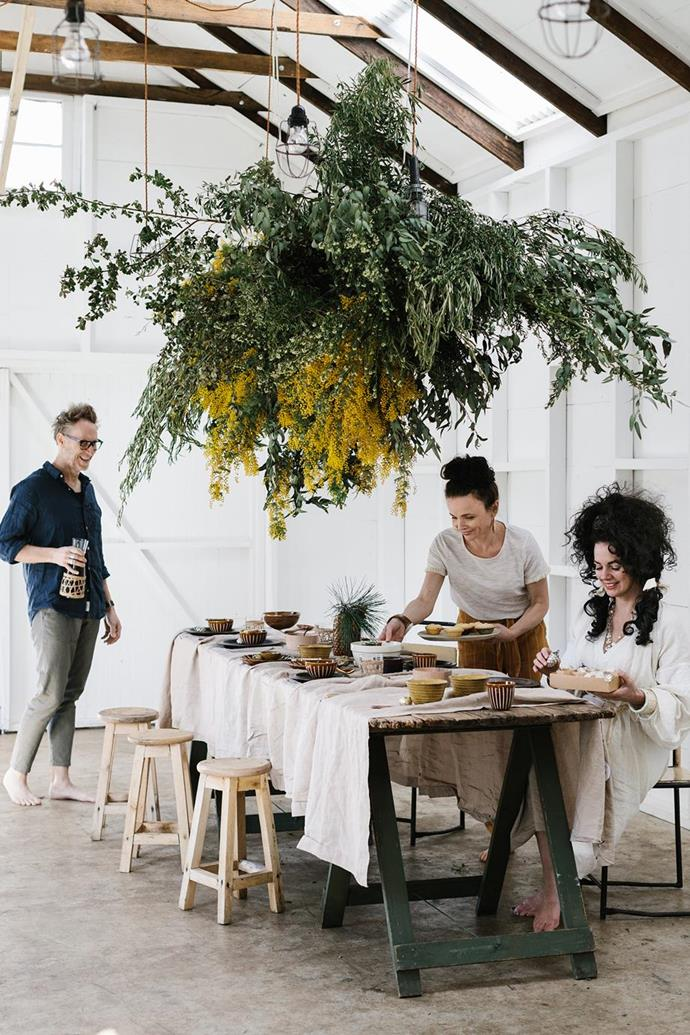 """Nothing says Christmas in Australia like greenery displays, so why not go bold and create a magnificent foliage installation as a surrogate Christmas tree above the table setting like this display in [Lynda Gardener's Federation era cottage](https://www.homestolove.com.au/federation-era-cottage-trentham-19487
