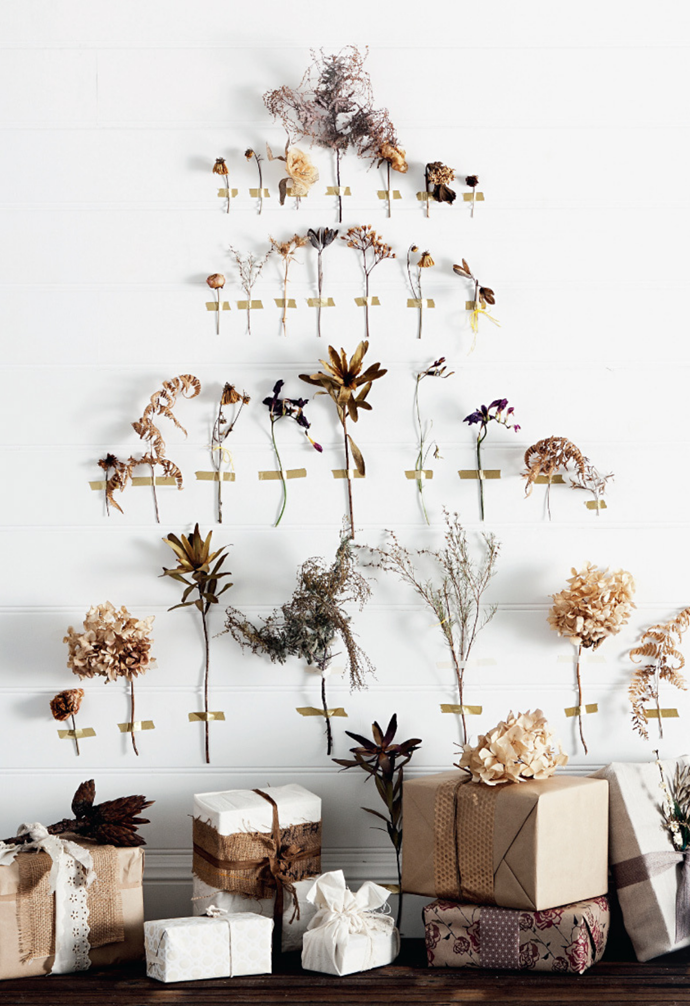 This inventive washi tape tree with dried flowers turns a blank wall into a beautifully creative neutral-hued Christmas tree.