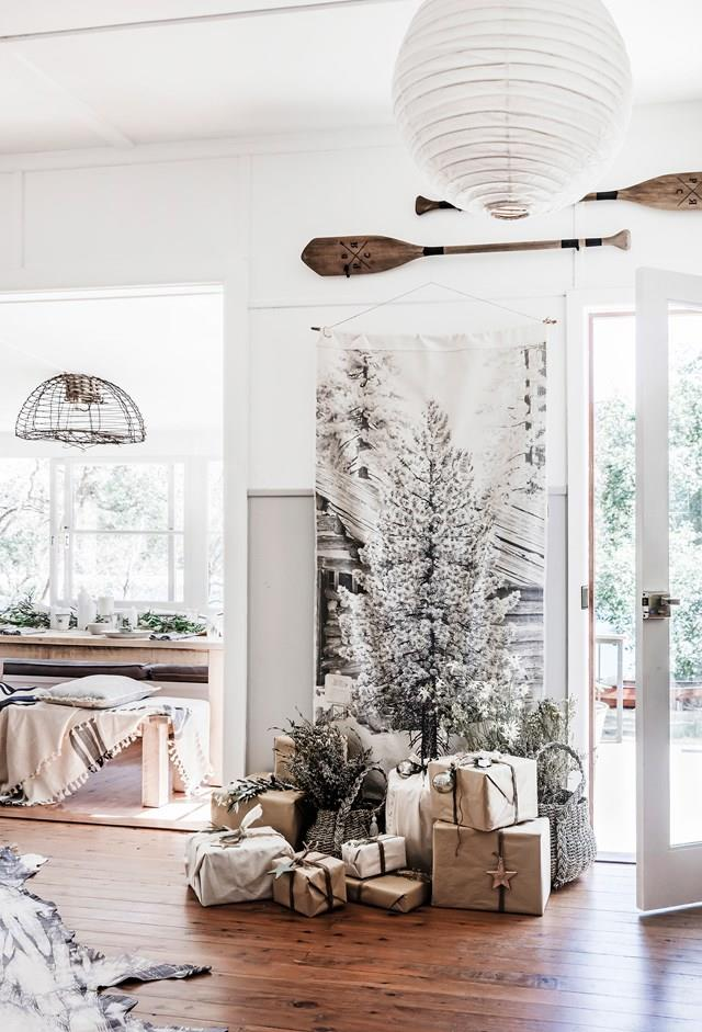 """A painted or printed canvas Christmas tree like this one in a [secluded beach shack north of Sydney](https://www.homestolove.com.au/a-nautical-inspired-beach-shack-north-of-sydney-6175