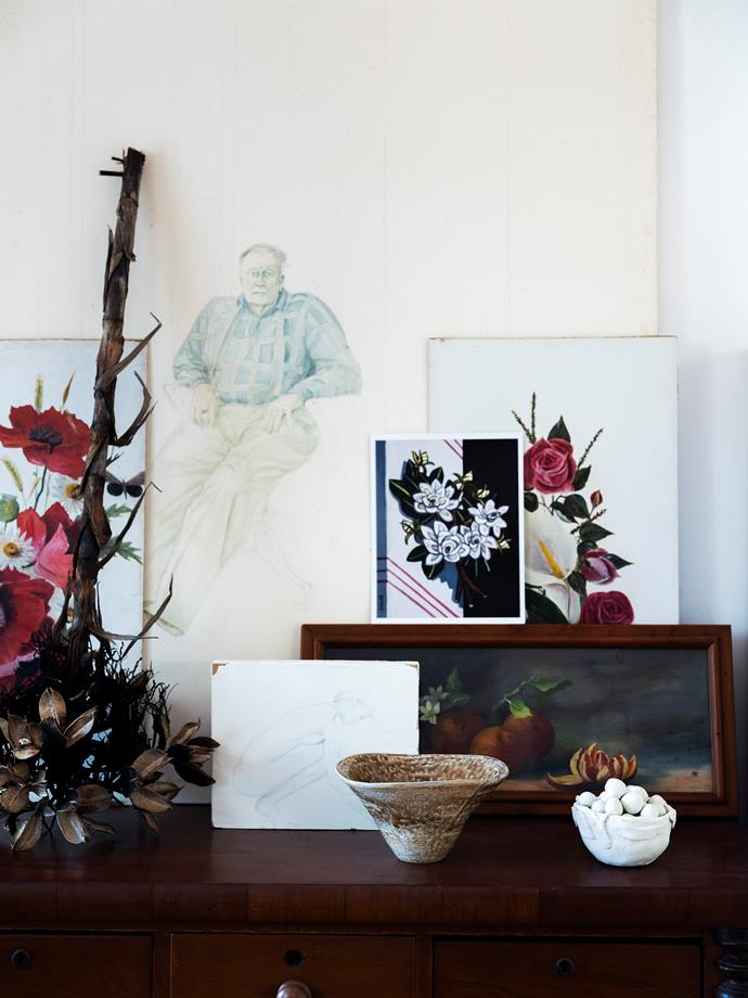 Artfully arranged works in the studio include a portrait of Michelle's dad and paintings by great aunt Edith and Michelle's grandmother. The white bowl is one of Michelle's pieces, the taupe vessel was a gift from a friend.