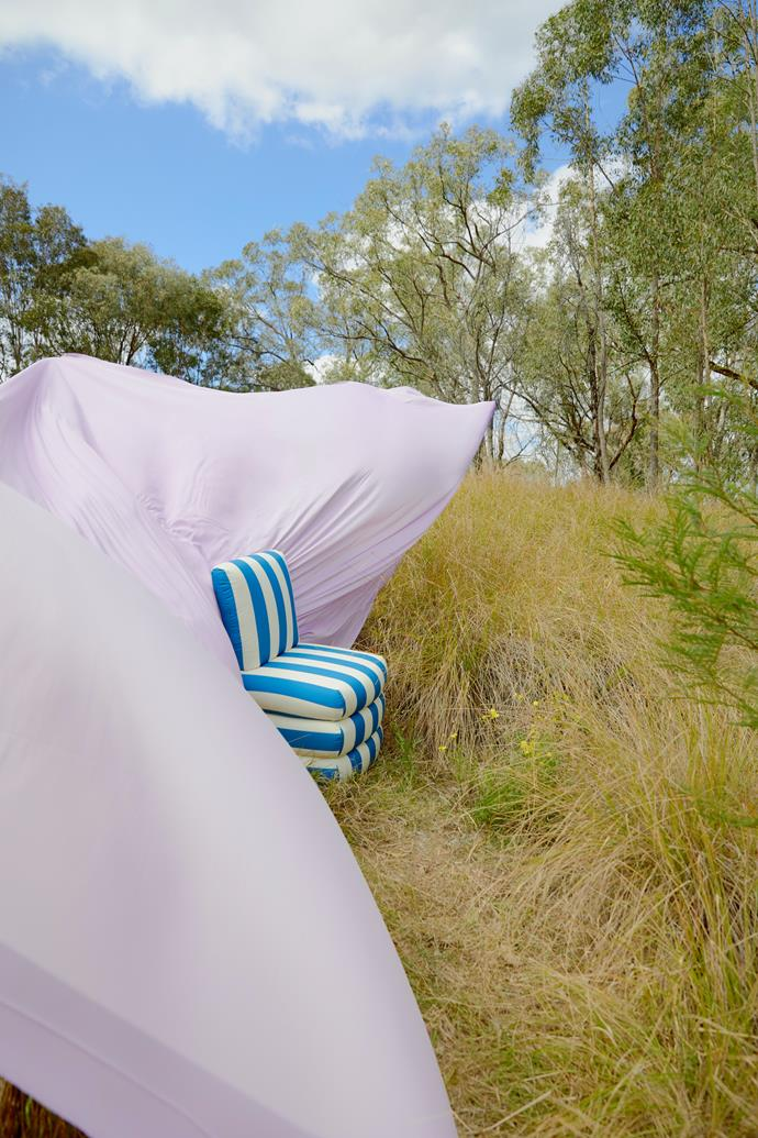 Ash NYC 'Pillow' chair in Blue, Studio ALM. Celine sandwash satin fabric in Lilac, $16.99 per m, Spotlight.