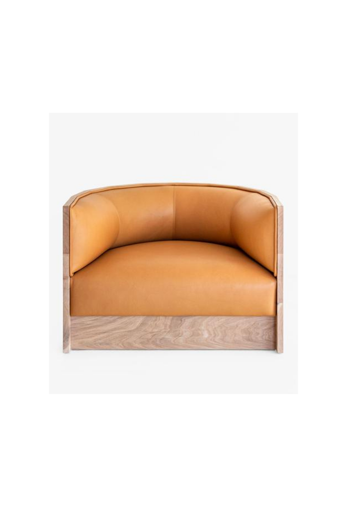 "Barrel armchair in Ranchero leather, $4840, [Mr and Mrs White](https://www.mrandmrswhite.net/products/barrel-arm-chair|target=""_blank""
