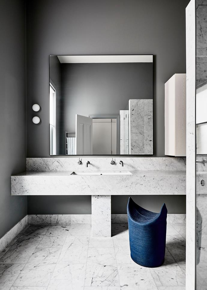In the master ensuite Flos 'Glo-Ball' mini wall lights from Euroluce hang next to a mirror from David Glass. Doug Johnston 'Two Stool' from Criteria. The floor tiles are Cararra marble.