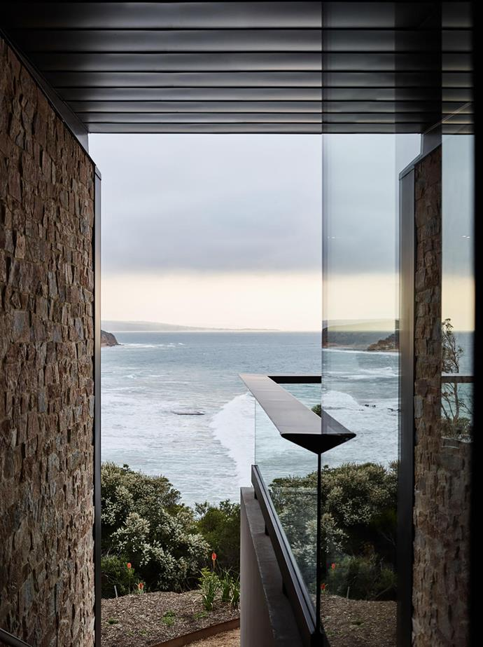 The ocean view is framed by the earthy material selection of Coolum limestone on the wall and zinc cladding on the eaves.