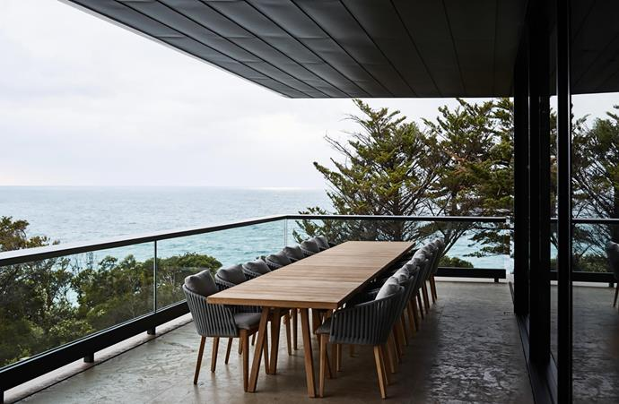 The house creates many opportunities for outdoor dining and relaxing while engaging with the natural context. Materials are kept muted as seen in the Tribù 'Vis à Vis' outdoor table and 'Mood' armchairs in solid teak, all from Cosh Living.