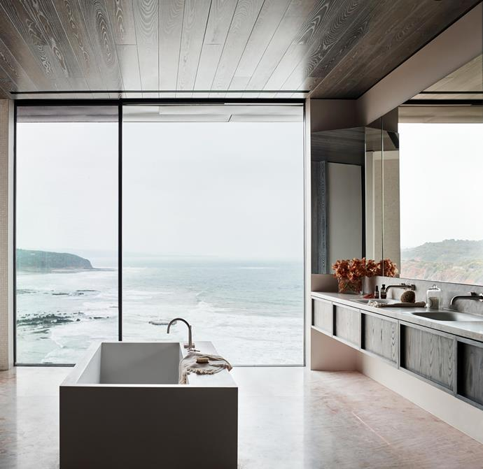 The absence of decoration in deference to the alluring view from the bathroom is the ultimate in luxury. Bespoke vanity, splashback and flooring clad in Cristallo quartzite and custom-stained solid-timber unit by The Restorators.  Boffi 'Swim-c' bath with shelves by Piero Lissoni, Icon hob-set taps from Astra Walker, towel from Loom Towels and accessories from Abode Living.