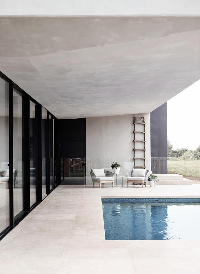 Set with a pair of Tribù 'Mood' club chairs from Cosh Living, the sheltered pool area offers an excellent place to relax.
