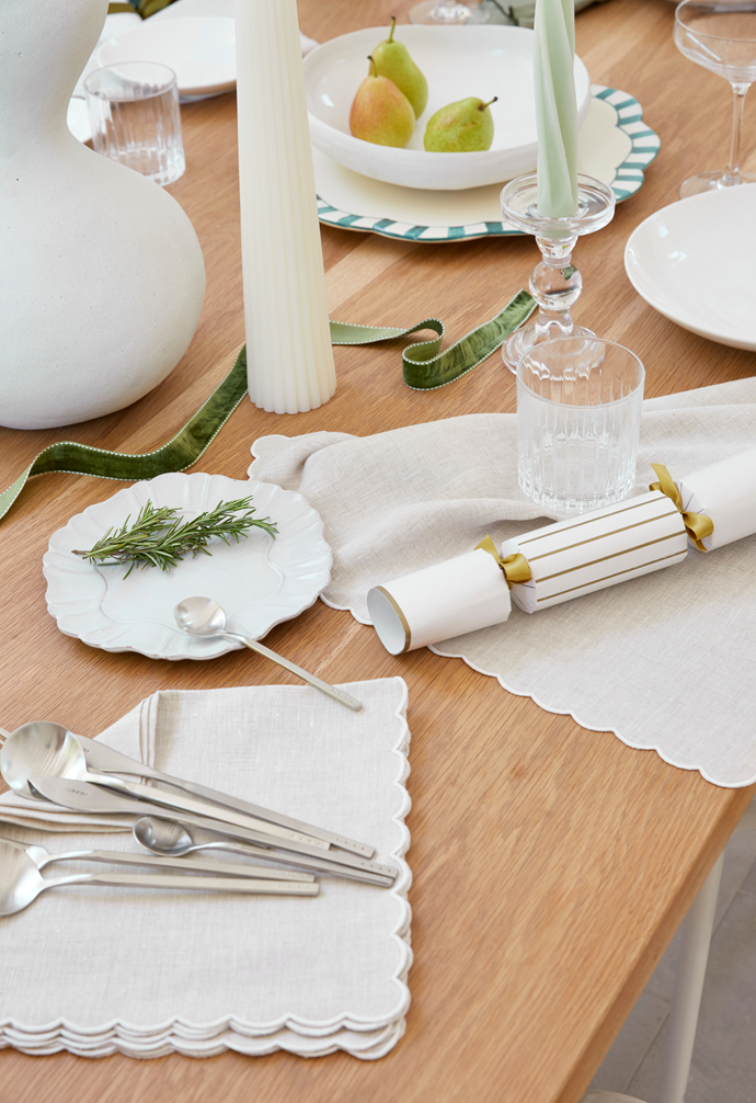 Scallop embroidered dinner napkins in Oatmeal, $100 for set of 2, Elizabeth Lake. Fluted pillar candle in Ivory, $125, Love After Love.