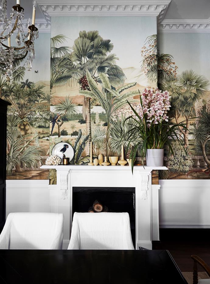 Breathtaking Iksel 'D-dream' wallpaper from Boyac is the ultimate conversation starter as guests gather around the table for a meal. Beeswax candles on mantelpiece from The Nuptial Collective. Decorative plate, Ginori 1735.