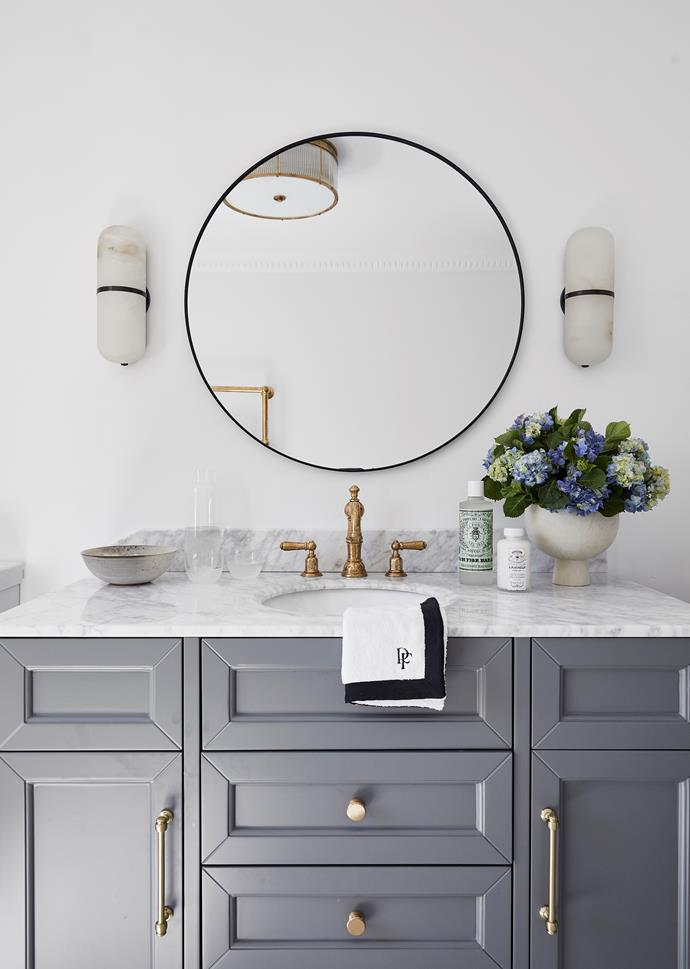 The guest ensuite features a vanity from Vanity by Design and Perrin & Rowe taps from The English Tapware Company. Mirror, Kmart. Kelly Wearstler wall light, The Montauk Lighting Co.