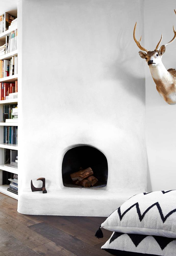 "**Fireplace** Located at the junction between dining room and the kids' rumpus room, the fireplace has been redesigned and rendered. Taxidermied reindeer, bought from a farmer in Victoria. Floor cushions, [Amara Home](https://www.amara.com/au|target=""_blank""