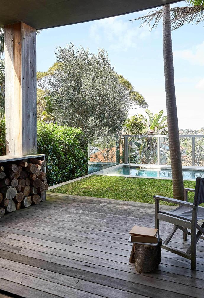 "**Backyard** ""The palm tree was pre-existing, but we raised the lawn 1.5 metres so the trees have a suspended lawn surrounding them,"" Sarah explains. The spotted-gum deck will weather naturally over time. Ida deckchair, [Eco Outdoor](https://www.ecooutdoor.com.au/