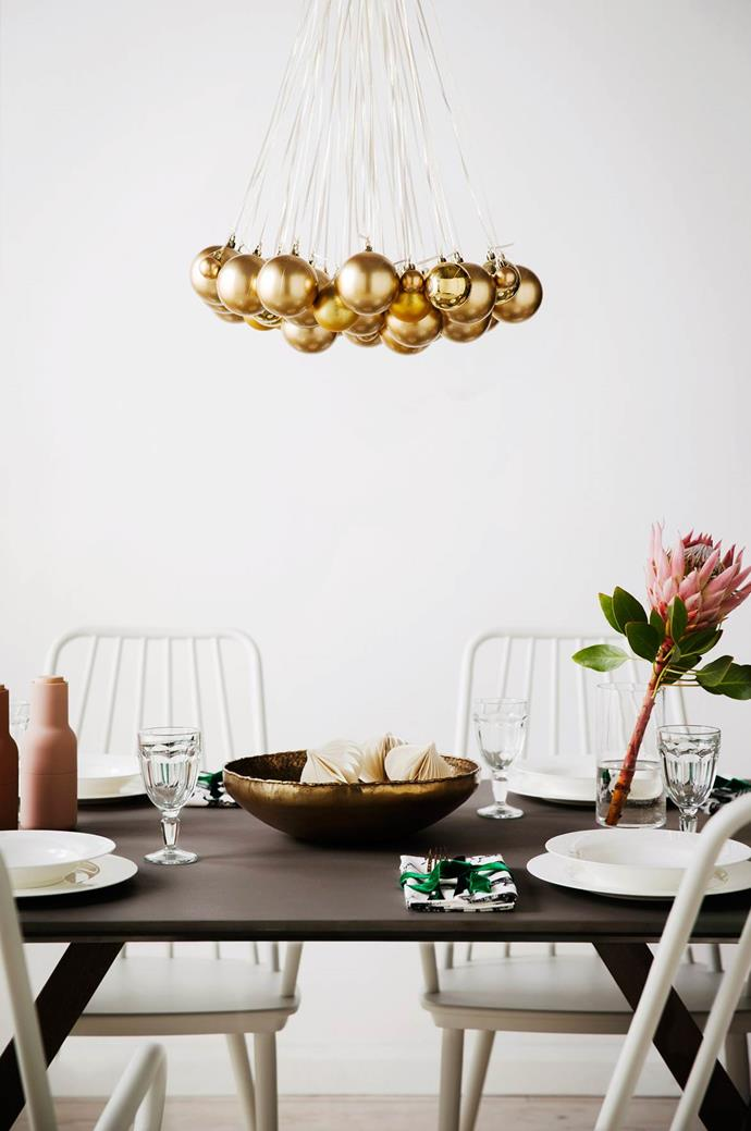 Free up table space and enjoy the reflected light from a centrepiece of baubles hung overhead.