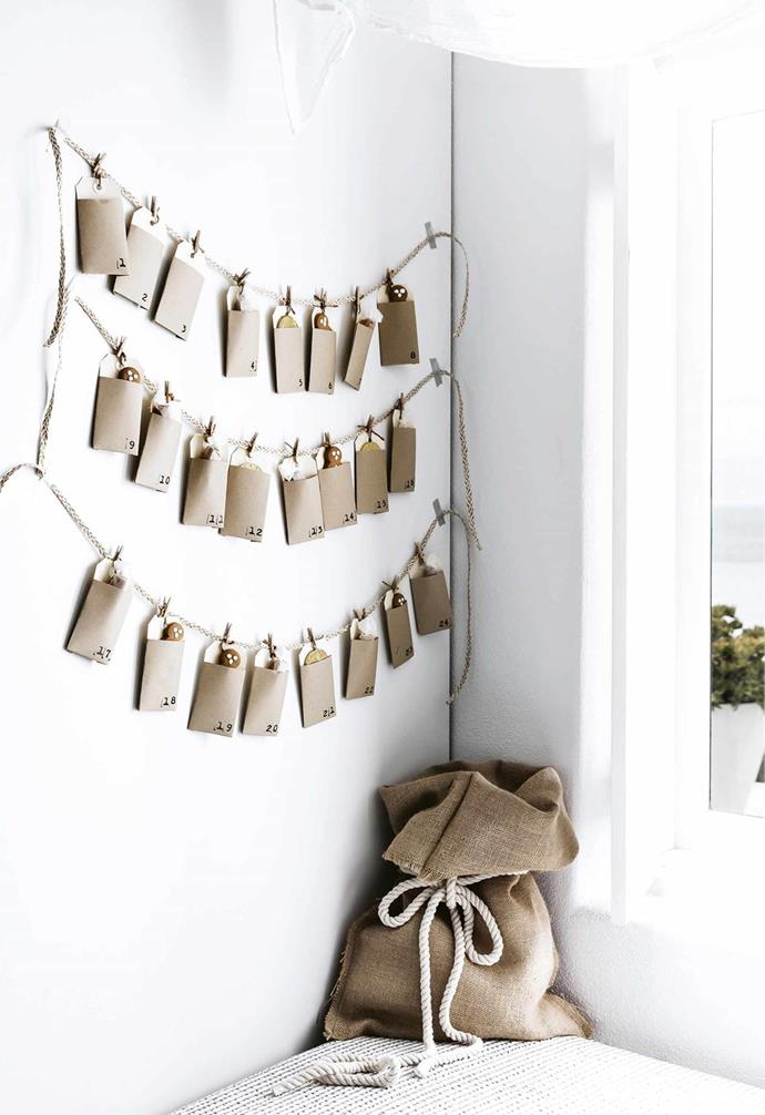 A creative take on an advent calendar comes together in this [family home](https://www.homestolove.com.au/mediterranean-style-all-white-home-16945 using tags and pegs from Paper2, while a Santa sack sets the mood for fun.