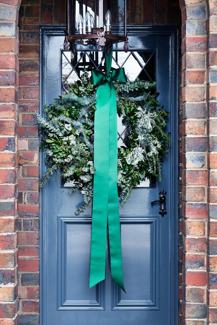A silver dollar gum wreath with its statement satin bow makes a bold first impression to Chyka Keebaugh's.