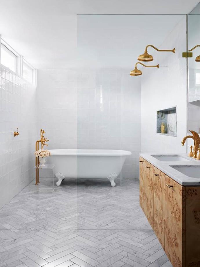 "A claw-footed bath becomes the centre of relaxation in the gold-accented glamorous bathroom of an [1880s terrace](https://www.homestolove.com.au/glamorous-makeover-of1880s-terrace-21031|target=""_blank"") in Sydney."