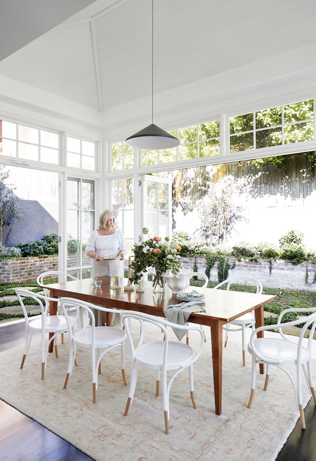 "This radiant conservatory was part of a six-month renovation to restore and return a [1920s home](https://www.homestolove.com.au/restored-heritage-home-sydney-21929|target=""_blank"") to its pomp. A recycled timber table, custom made by Original Finish, and Thonet Le Corbusier bentwood chairs offer style sense, and the Hali Uşak rug from Smithmade lends faded loveliness."