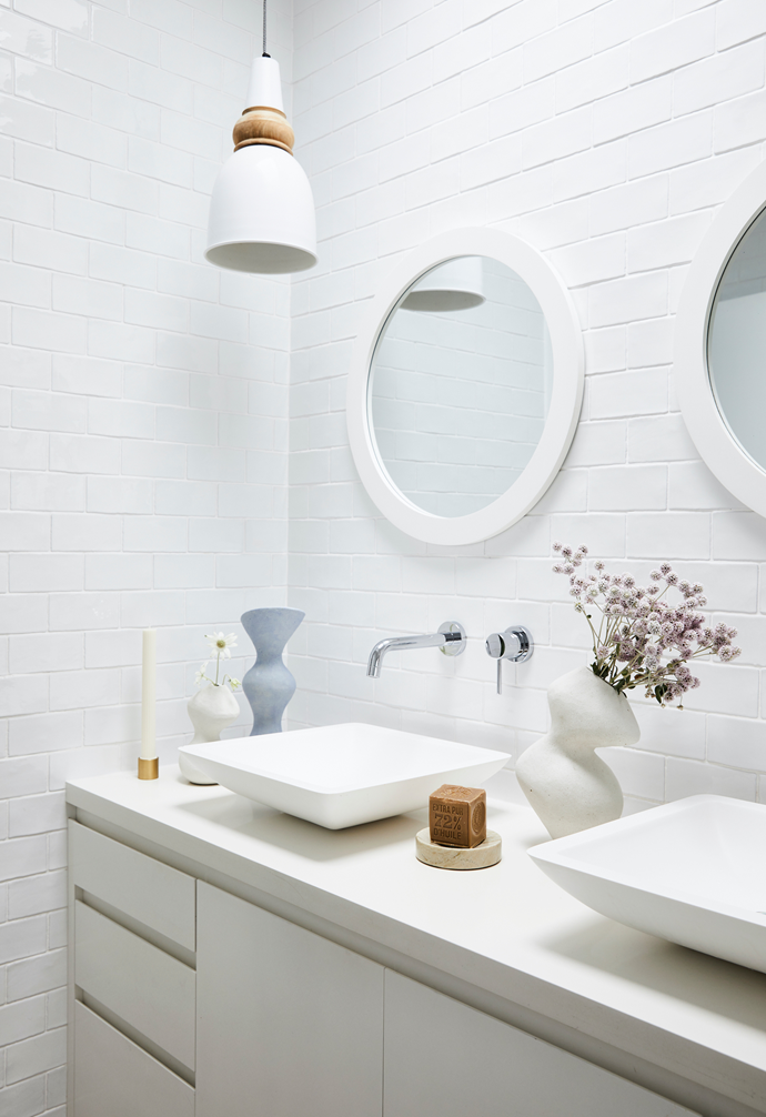 The neutral colours continue in the bathroom with a custom vanity, basins by ACS Bathrooms and a pendant from Indigo Love. The ceramics are Sophie's, the candle is by Black Blaze and the soap and dish are both from The Lost+Found Department.