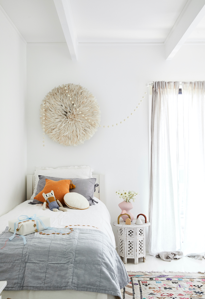 Beautiful bedding and a handmade Juju hat will stand the test of time in this kids' room. Cushions and toys from Kido Store; grey pillowcase by Shannon Fricke.