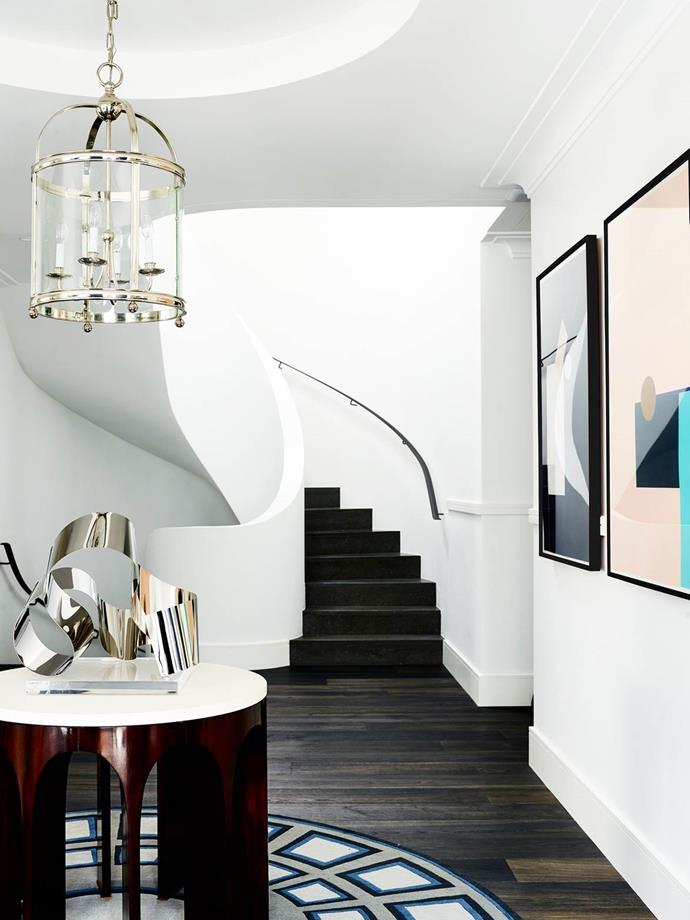 """A sinuous, ribbon-like circular staircase connects the three floors of this [Art Deco home in Sydney's eastern suburbs](https://www.homestolove.com.au/sydney-art-deco-home-by-interior-designer-greg-natale-4648