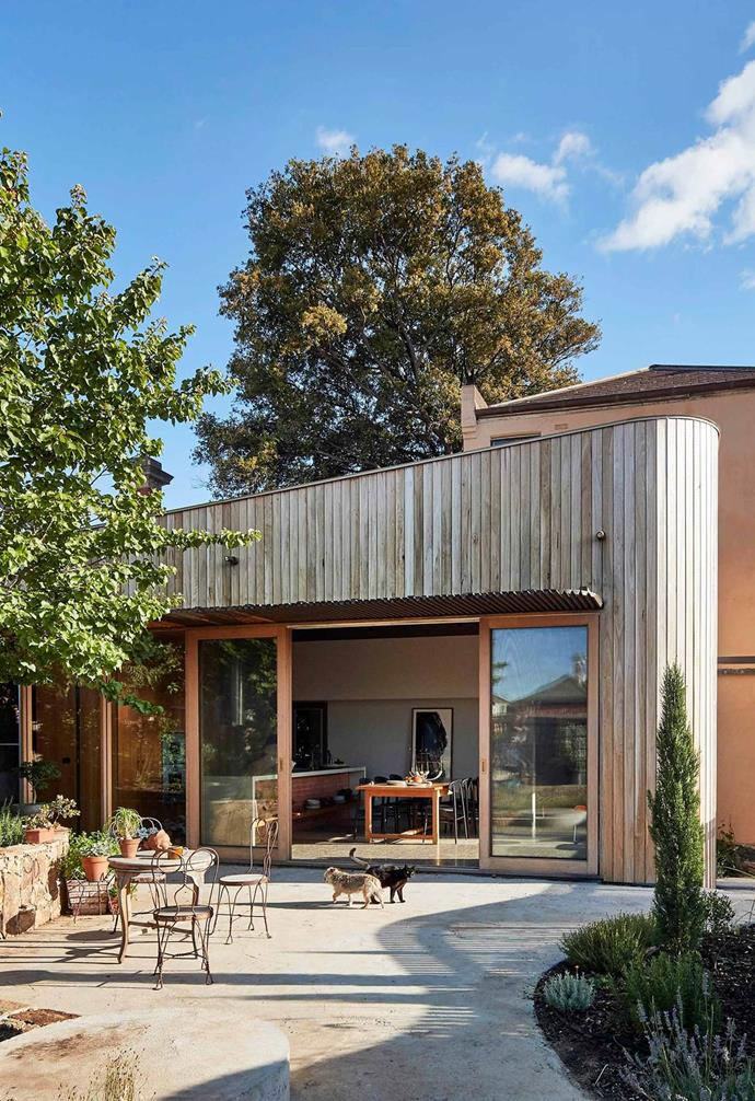 """The [contemporary extension of this Victorian terrace](https://www.homestolove.com.au/timber-clad-terrace-extension-20886