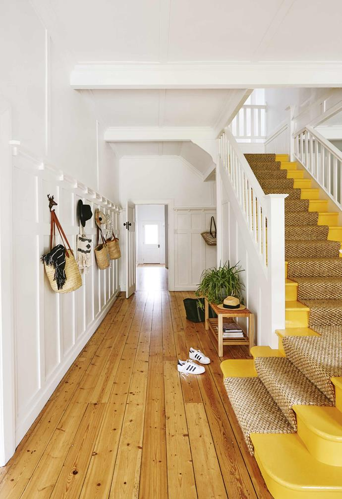 """A vibrant yellow staircase adds a pop of cheerful colour throughout this [coastal Californian bungalow](https://www.homestolove.com.au/californian-bungalow-barwon-heads-17909
