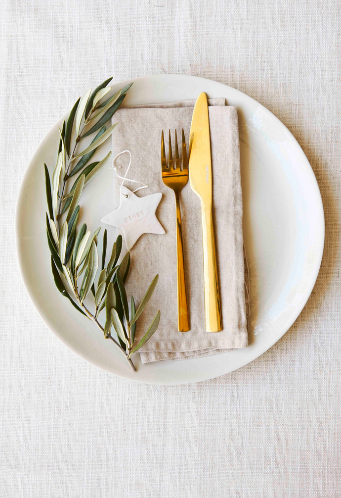 """**Tip: ** Display handmade name tags atop linen napkins and decorate your [Christmas table settings](https://www.homestolove.com.au/christmas-table-setting-ideas-pictures-4419