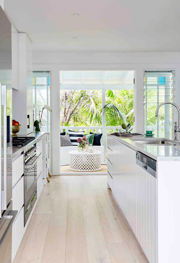 Often tasked with creating gorgeous kitchens for other people, interior architect Sally was thrilled to design one for herself, and she indulged in some of her favourite materials – V-groove cabinetry and Carrara marble – to create this classic coastal-style space. Timeless features, from the Perrin & Rowe tap to the bar stools from Provincial Home Living, are mixed with modern finishes, including sleek cabinetry.