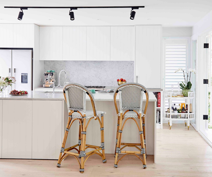 """This hard- working space also hides a secret – a laundry is concealed behind bi-fold cabinets at the front of the island. """"This meant the island needed to be extra wide, but that has made for a real showstopper bench that has tonnes of prep space,"""" says Sally."""