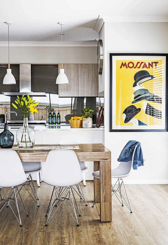 "Incorporating yellow into your home's interior doesn't have to involve large-scale projects or dramatic permanent features. In the open-plan kitchen and dining area of [this modern-classic home](https://www.homestolove.com.au/gallery-katie-and-nathans-modern-classic-new-build-1969|target=""_blank""), a vintage Mossant print adds a vibrant pop of colour."