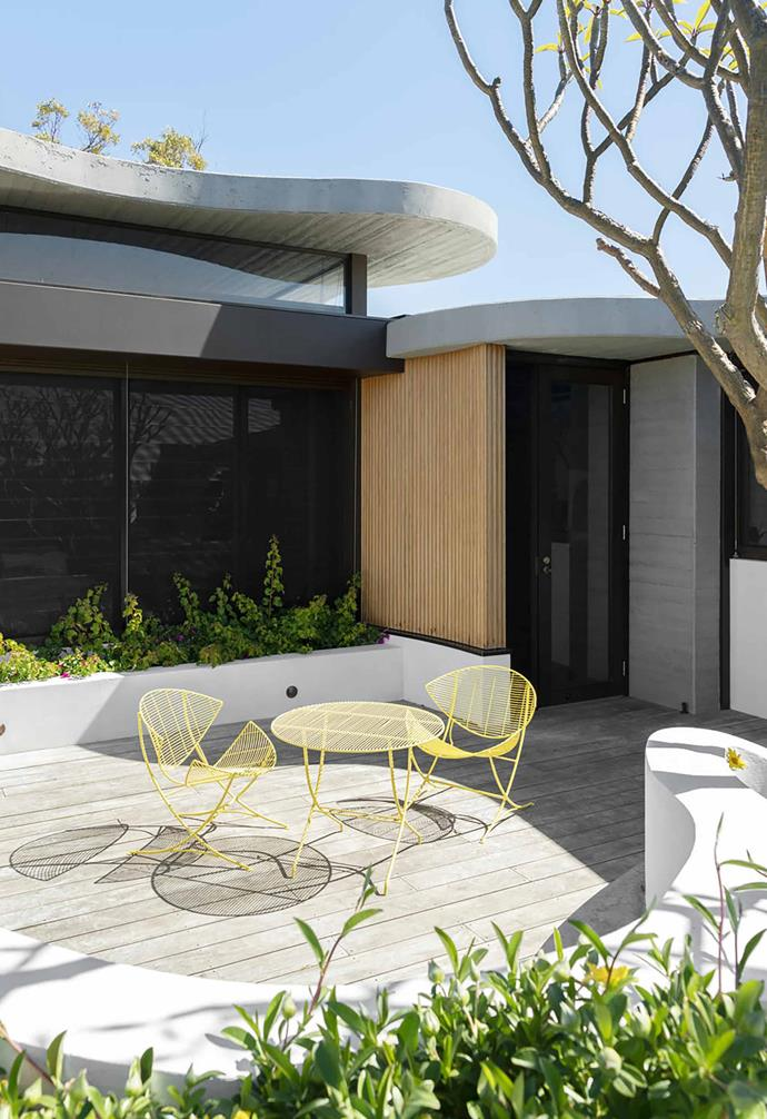 "Embracing cool concrete and modernist design, [this contemporary home](https://www.homestolove.com.au/a-concrete-house-with-modernist-lines-19654|target=""_blank"") features decorative touches of colour to provide contrast throughout. In the courtyard a sunny yellow outdoor dining setting is a highlight."