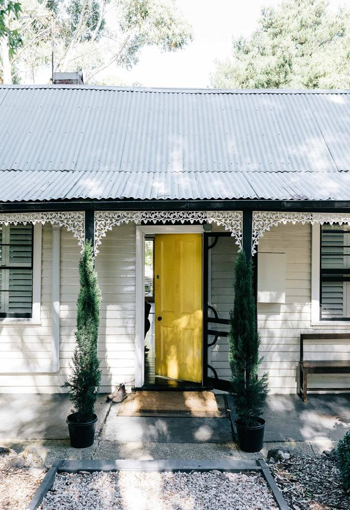 "This [revamped miner's cottage in Daylesford](https://www.homestolove.com.au/miners-cottage-renovation-daylesford-21894|target=""_blank"") features a sunny yellow front door that creates a warm sense of welcome in the front garden."
