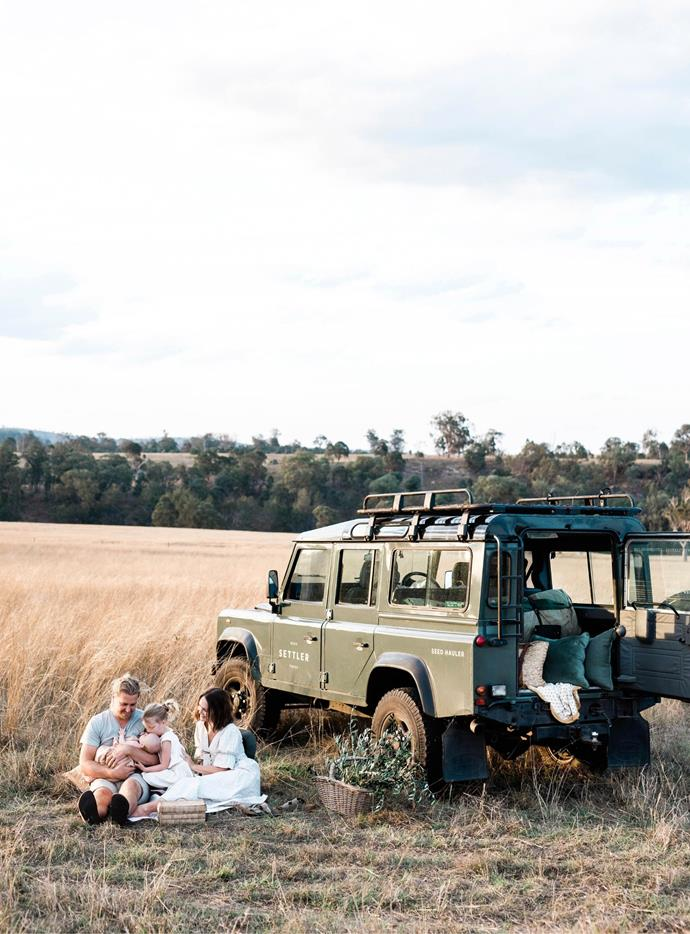 """The Masons enjoy a picnic in the paddock at Roger's parents' property. """"One of our favourite things to do is catch the sunset,"""" Hayley says. """"When we sit down and discuss what to do if it doesn't rain, we can't make a plan because we don't know we want to be anywhere else."""""""