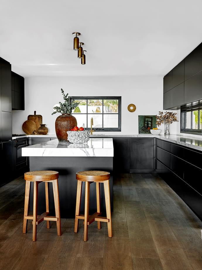 The Calacatta marble on the kitchen bench tops and island is from SNB Stone. Kitchen joinery by Art of Kitchens. Otsumigaki wall finish by Triple A Rendering. Artwork by mid-century Swedish artist Alf Lindberg. Vintage French sconces from Chiara Colombini.