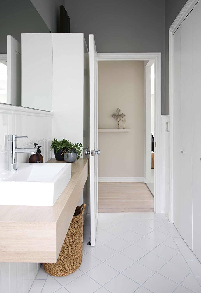 **Bathroom** Blonde timber and potted plants add warmth to the cool space.